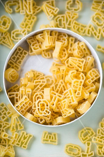 Alphabet pasta in a tin (seen from above)