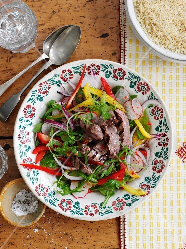 Summer salad with vegetables and grilled beef