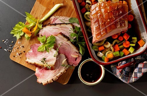 Crispy roast pork with balsamic sauce and colourful vegetables (seen from above)