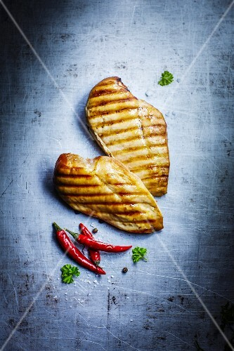 Two grilled chicken fillets (seen from above)