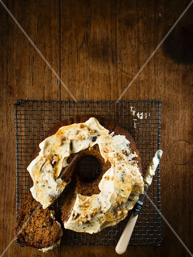 Pumpkin cake with walnuts, dates and maple syrup and cream cheese frosting