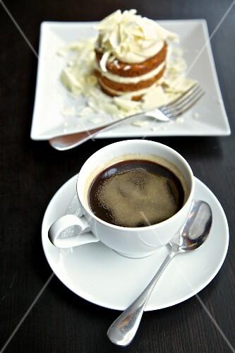 Black coffee and chocolate tart on a dark surface