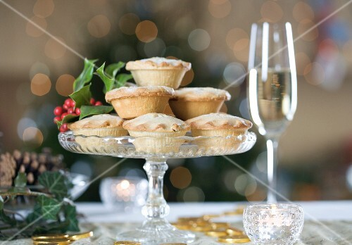 Mince pies for Christmas on a glass cake stand