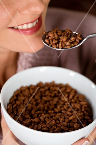 A woman eating chocolate crispies