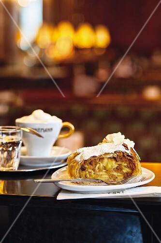 Viennese coffe houses, apple strudel with cream in Café Landtmann, Vienna