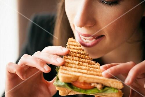 A woman eating a sandwich (close-up)