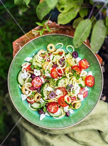 Greek salad with spiralized courgette, tomatoes, cucumber, feta cheese and olives