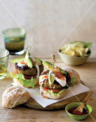 Mexican bean burgers with avocado, yoghurt and chilli sauce