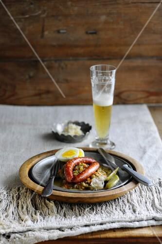 Sausages on a lentil medley with a hard-boiled egg