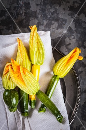 Courgette flowers on a cloth