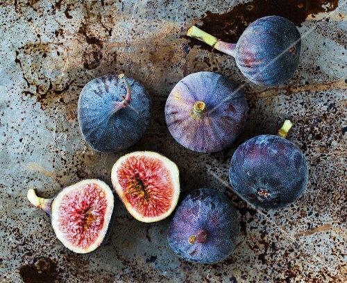Fresh figs, seen from above, one halved
