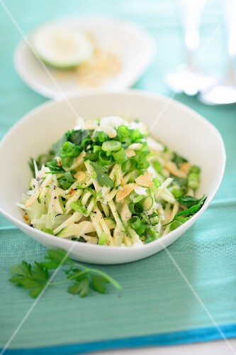 Raw kohlrabi with spring onions and parsley