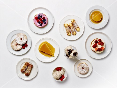 A dessert buffet with cakes, pastries, tartlets and ice cream