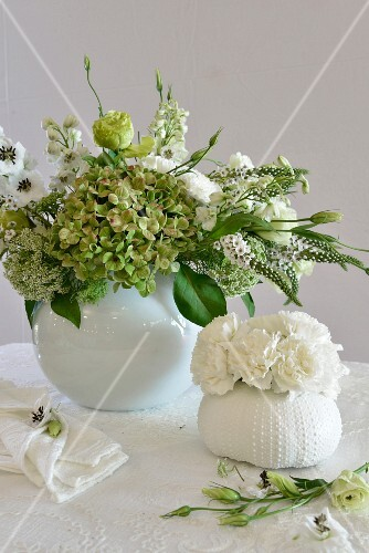 Romantic, white and green arrangement of hydrangeas and carnations