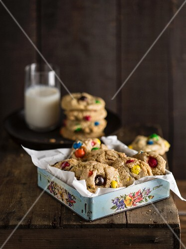 Cookies with colourful chocolate beans in an old-fashioned biscuit tin