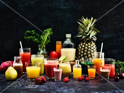 Various fruit juices and smoothies in glasses