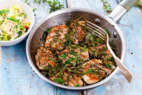 Grilled pork medallions with herbs