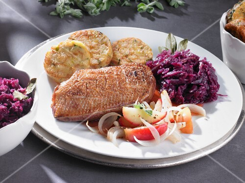 Duck breast with roasted bread dumplings and red cabbage