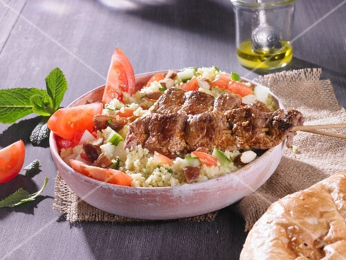 Couscous tabbouleh with meat kebabs and pitta bread
