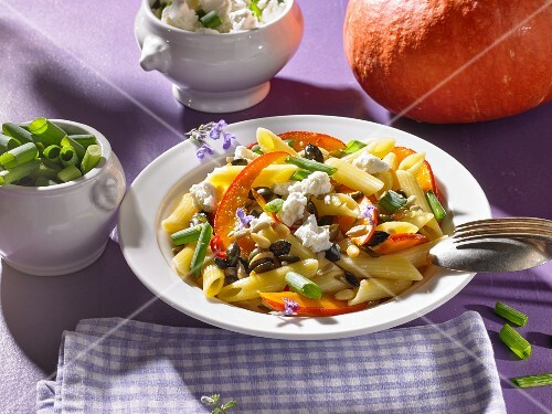 Pasta with pumpkin, feta cheese and sunflower seeds