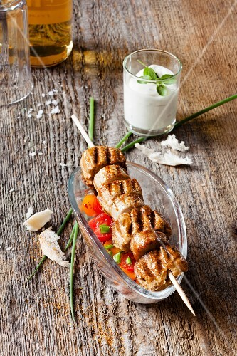 Sausage and bred kebab with a sour cream dip