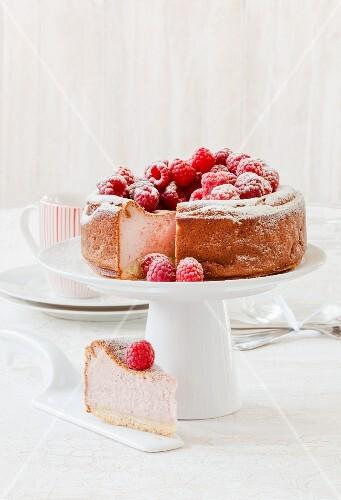 Raspberry cheesecake on a cake stand