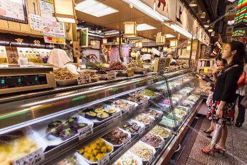Customers waiting at a Japanese cookshop, Nishiki Market, Kyoto