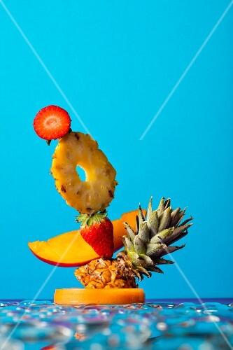 A fruit sculpture against a blue background