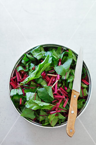 Tender beetroot leaves in a bowl (seen from above)
