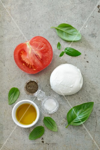 Ingredients for caprese: tomatoes, mozzarella and basil