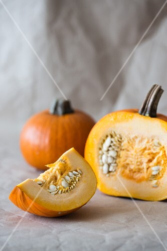 Pumpkins, whole and sliced