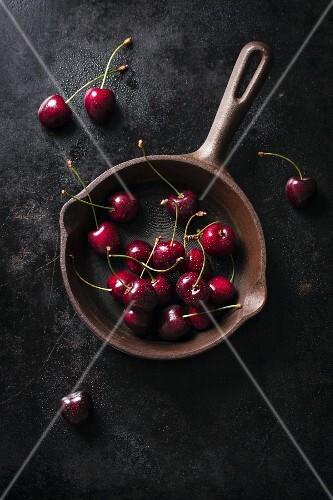 Fresh cherries in an old pan