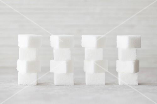 Several stacks of sugar cubes