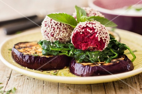 Beetroot falafel with spinach and aubergines