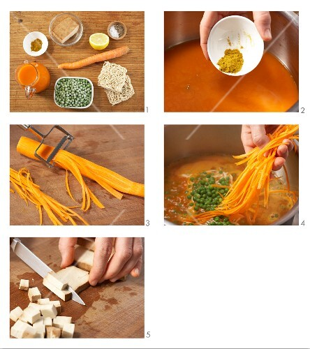 Carrot pasta stew with peas being made