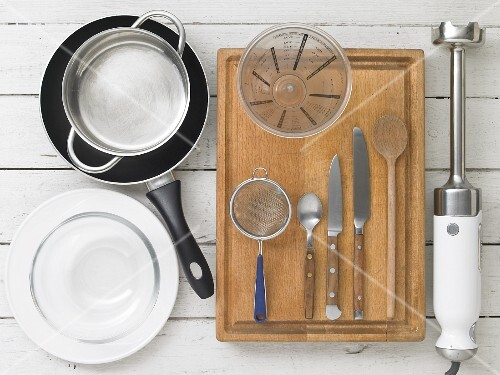 Kitchen utensils for making spiced tea and fig and sesame seed bread