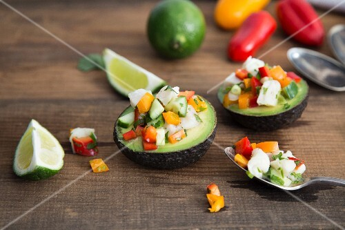White fish ceviche with cucumber, peppers and coriander served in an avocado