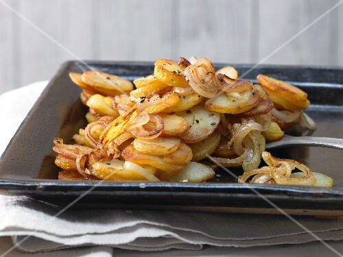 Home-made fried potatoes with onions