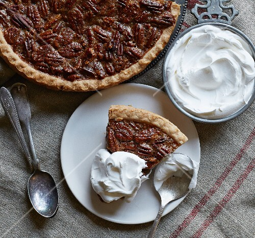 Pecan pie with whipped cream (seen from above)