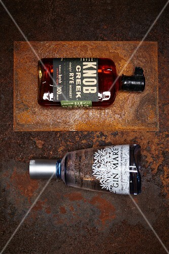 Bottle of rye whiskey from Knob Creek and Gin Mare (seen from above)