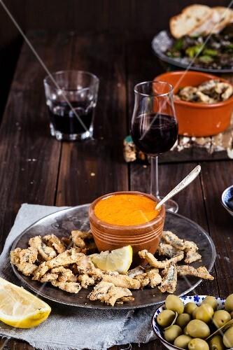 Tapas: Boquerones fritos (fried anchovies with lemon and mojo rojo, Spain)