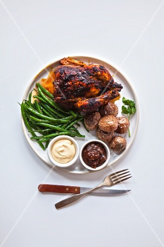 Grilled chicken, roasted potatoes, green beans, barbecue source and mayonnaise