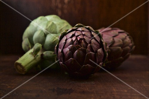 Artichokes on a wooden surface