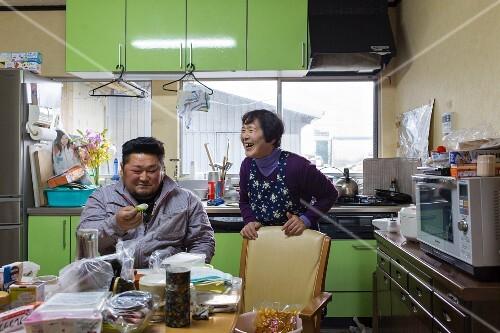 Rice farmer Takahiro Fukunaga and his mother in the kitchen (Fukuoka, Japan)