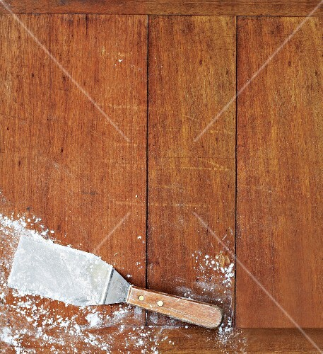A baker's peel on a wooden surface