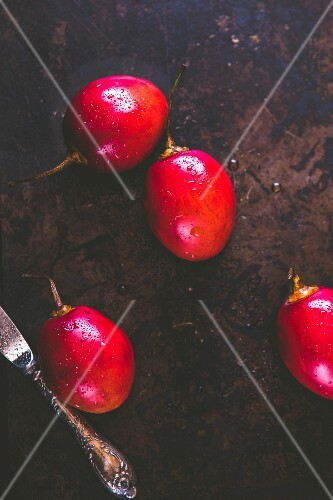 Tamarillos with drops of water