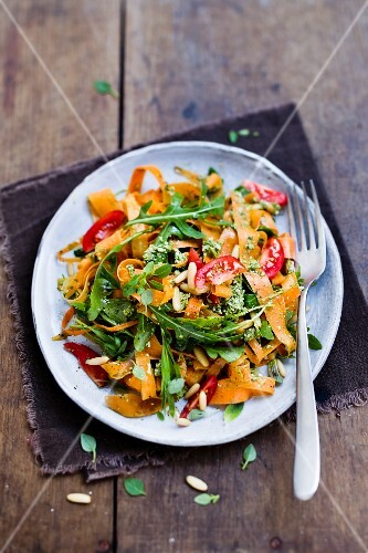 Carrot tagliatelle with tomatoes and rocket