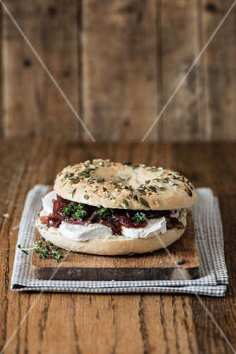 A bagel with cream cheese and red onion chutney