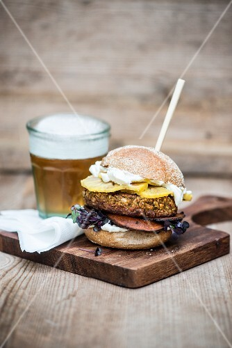 A veggie burger with a glass of beer