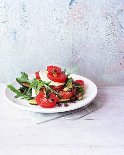 Tomato salad with courgette, mozzarella and rocket